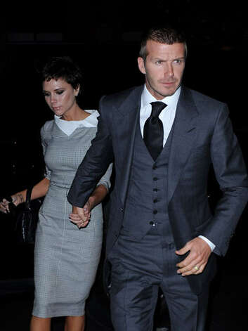 Victoria Beckham and David Beckham All Victoria needs is a necktie and they're virtually indistinguishable. / 2008 James Devaney