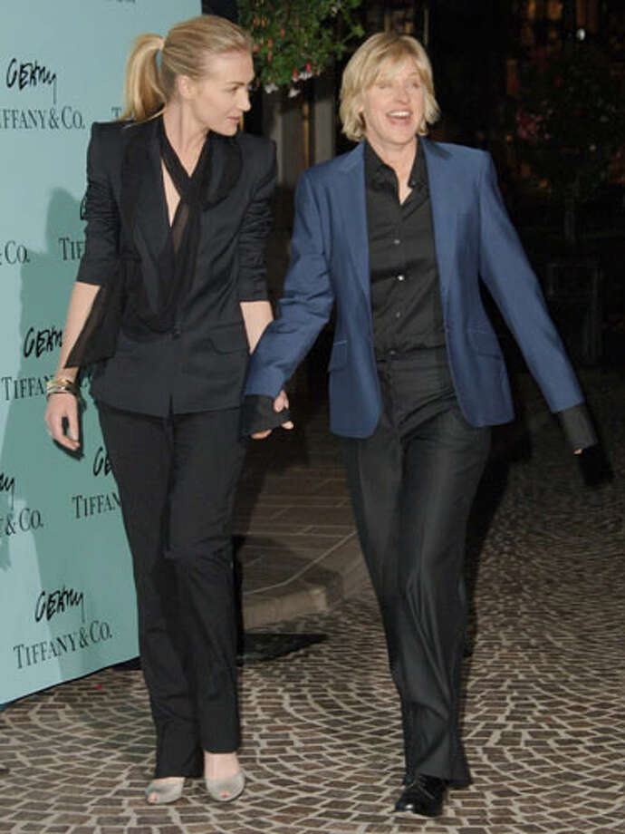 Ellen Degeneres and Portia De Rossi Ellen decided to distinguish herself from her wife by wearing a slightly different jacket.
