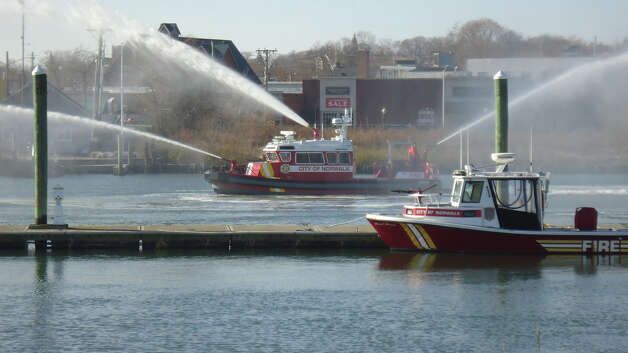 Norwalk Fire Boat MU 238 flows 2,500 gallons per minute from three deck guns at the commissioning ceremony Monday. Photo: Contributed Photo