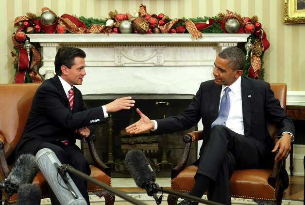 President Barack Obama meets with President-elect Enrique Pena Nieto of Mexico in the Oval Office of the White House, in Washington, Nov. 27, 2012.  According to the White House, Obama and Nieto are to discuss a broad range of bilateral, regional and global issues during their meeting. Photo: DOUG MILLS, New York Times / NYTNS