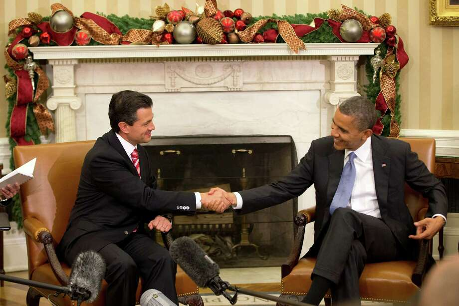 President Barack Obama shakes hands  with Mexico's President-elect Enrique Pena Nieto prior to their meeting in the Oval Office on Tuesday. Photo: Jacquelyn Martin, Associated Press / AP