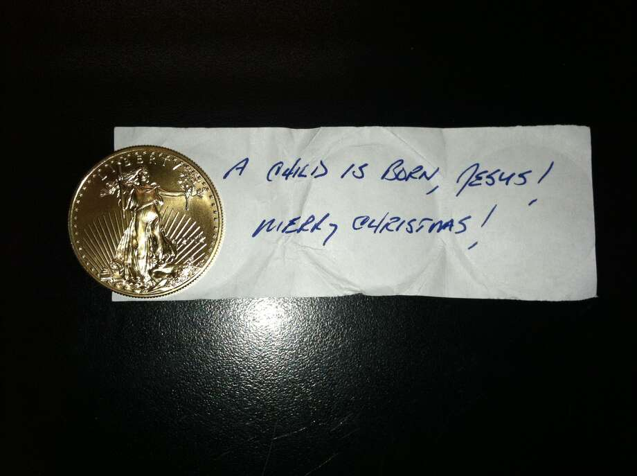 "The Houston area's first gold coin of the 2012 season has shown up at a Salvation Army red kettle in southwest Houston. The coin was wrapped inside a note that read, ""A child is born, Jesus!"" Photo: Salvation Army"