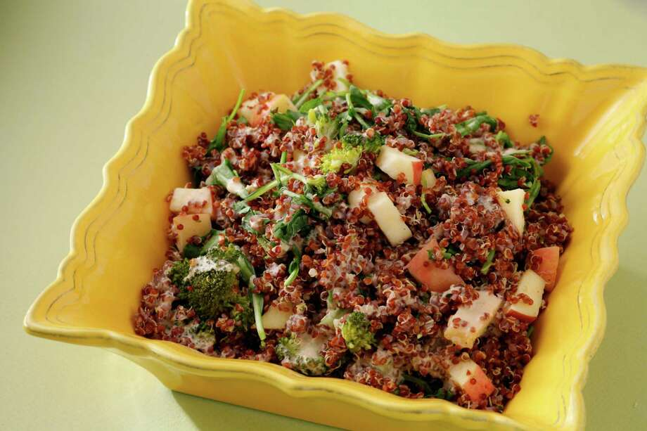 Warm Quinoa Salad with Broccoli, Apple and Arugula provides a tasty and satisfying side dish or a full meal. Photo: Craig Lee, Special To The Chronicle / ONLINE_YES