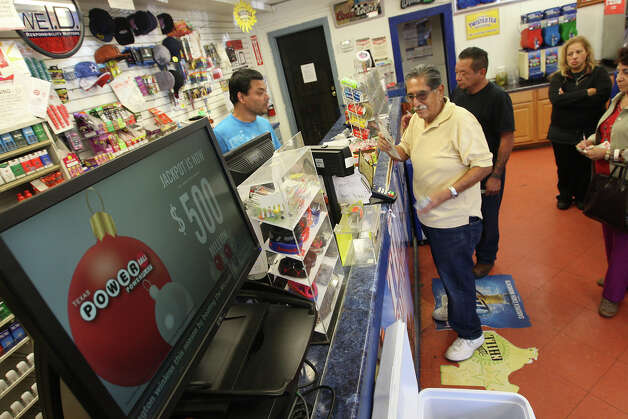 Mamum Azam, owner of Texas Food Mart, sells Powerball and other lottery tickets at his store on Cupples Road, Tuesday, Nov. 27, 2012. The estimated annuitized Powerball jackpot is at $500 million but is expected to climb. Photo: Jerry Lara, San Antonio Express-News / © 2012 San Antonio Express-News
