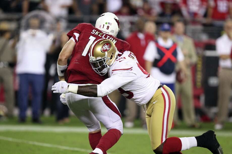 San Francisco 49ers' Aldon Smith, right, tackles Arizona Cardinals' John Skelton, left, in an NFL football game Monday, Oct. 29, 2012, in Glendale, Ariz. Photo: Paul Connors, Associated Press / FR5880 AP