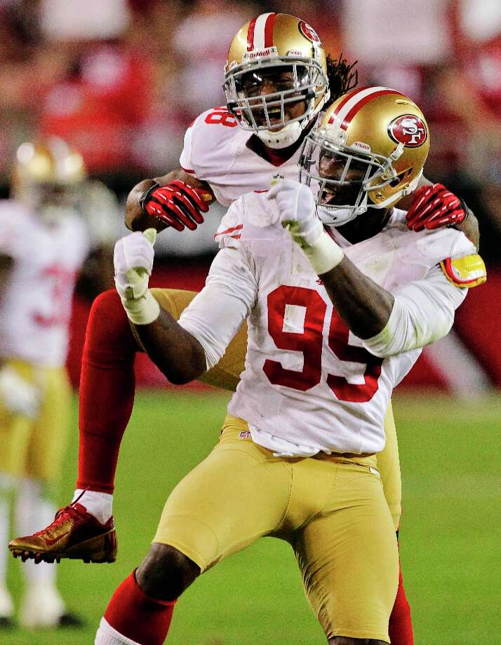 San Francisco 49ers outside linebacker Aldon Smith (99) celebrates his sack of Arizona Cardinals quarterback John Skelton with Parys Haralson during the second half of an NFL football game, Monday, Oct. 29, 2012, in Glendale, Ariz. Photo: Matt York, Associated Press / AP