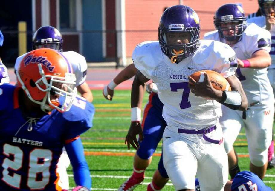 Davell Cotterell carries the ball as Danbury High School plays Westhill High School at Danbury Saturday, Oct. 20, 2012. (Michael Duffy)