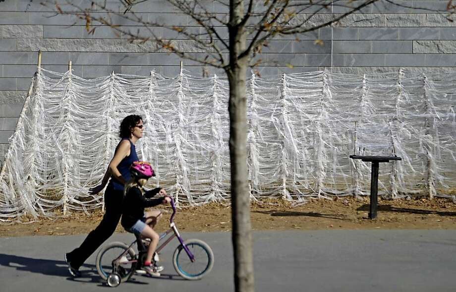 "Public art titled ""What Ties Me to You"" along the Atlanta BeltLine invites personal messages. Photo: David Goldman, Associated Press"