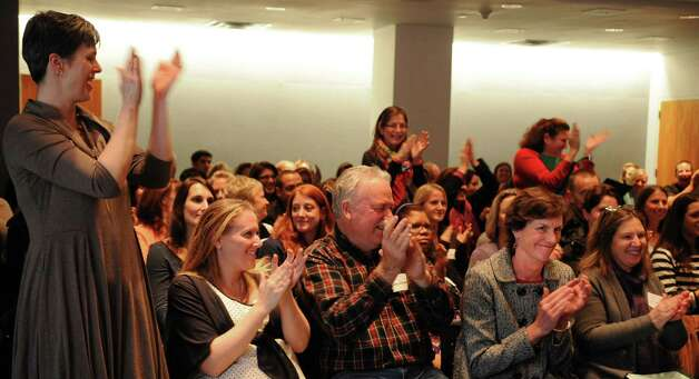 The crowd reacts as Springdale Elementary School is announced the winner of the Lone Pine Foundation's 6th-annual Fairfield County Academic Gain Award at the University of Connecticut's Stamford campus on Tuesday, November 27, 2012. Photo: Lindsay Niegelberg / Stamford Advocate