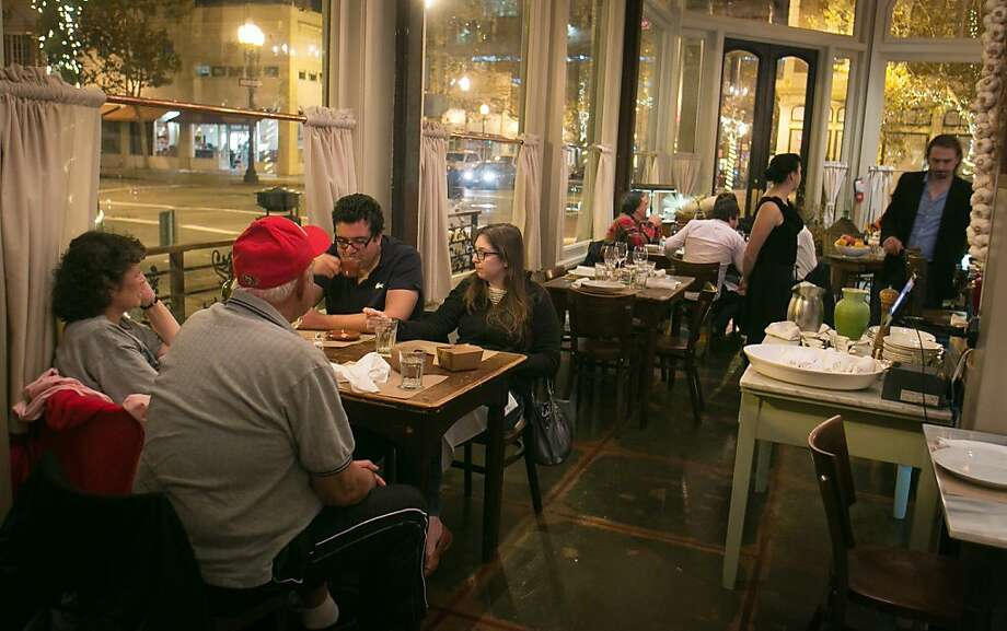 People have dinner at Borgo Italia in Oakland, which has an oddly harmonious homespun atmosphere and throbbing Buddha Bar beat. Photo: John Storey, Special To The Chronicle