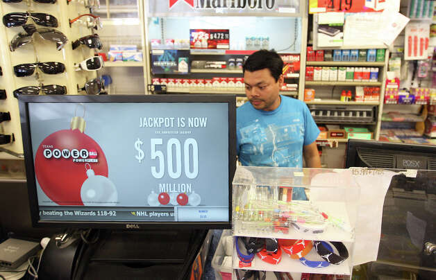 Mamum Azam, owner of Texas Food Mart, sells Powerball tickets, Tuesday, Nov. 27, 2012. The annuitized jackpot is at $500 million. The store sold a Texas Lotto ticket that won $22 million on February 16 of this year. Photo: Jerry Lara, San Antonio Express-News / © 2012 San Antonio Express-News