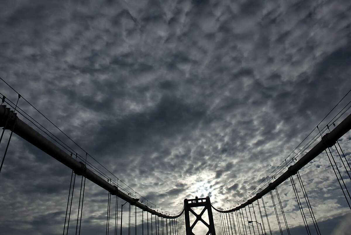 The middle tower of the western section of the Bay Bridge has a backdrop of storm clouds that are making their way across the region on Tuesday, November 27, 2012, in San Francisco, Calif. The San Francisco Bay Area will be hit by a series of storms starting Wednesday, that will last through Sunday, and could deliver several inches of rain to the region.