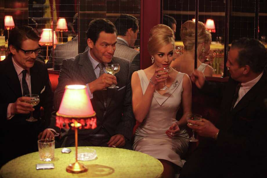 "Angus McCain (Julian Rhind-Tutt, from left), Hector (Dominic West), and Kiki (Hannah Tointon) are featured in ""The Hour."""
