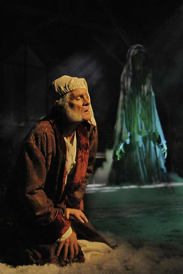 "Richard Farrell as Scrooge, in San Jose Rep's version of ""A Christmas Carol,"" confronts the Ghost of Christmas Future. Photo: Kevin Berne"