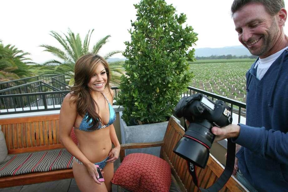 Felicia checks out her photos. (Jack Arent / Warriors.com)