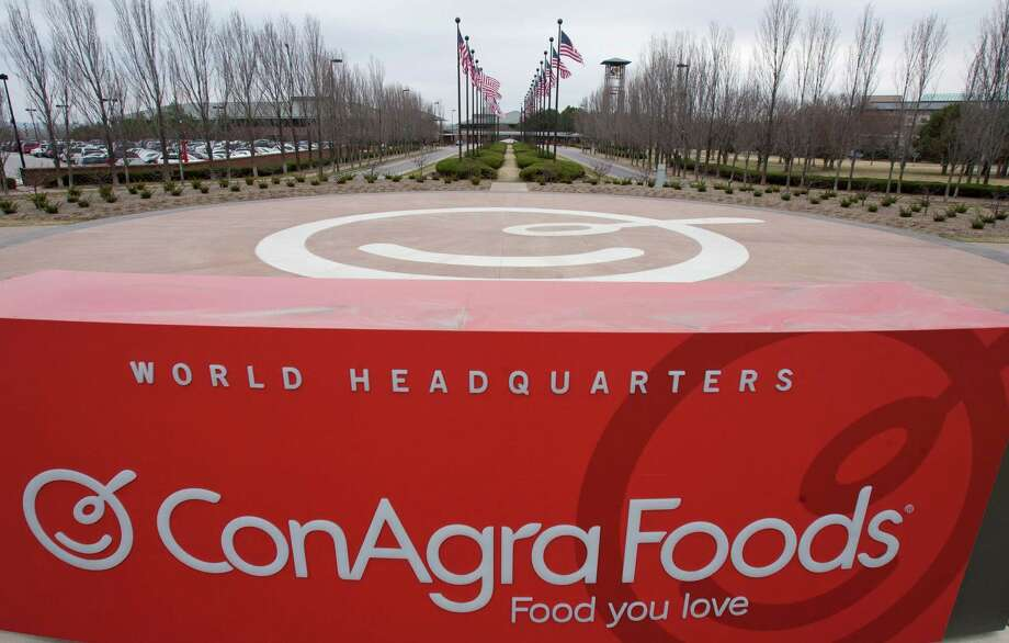 This March 21, 2011, file photo shows a sign for ConAgra Foods' world headquarters in Omaha, Neb. ConAgra Foods is buying private-label food producer Ralcorp for about $4.95 billion, which will make it the biggest private-label packaged food business in North America. ConAgra Foods Inc. said Tuesday, Nov. 27, 2012, that the deal is expected to close by March 31, 2013 and needs Ralcorp shareholder approval. (AP Photo/Nati Harnik, File) Photo: Nati Harnik