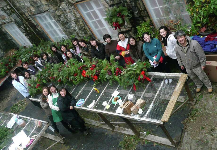 A bird's-eye view of the talented group of volunteers who create the colorful hanging Christmas baskets that decorate downtown Greenwich. Photo: Anne W. Semmes