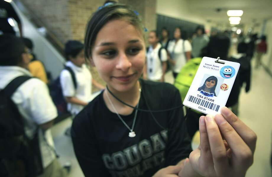 Tira Starr, an eighth-grader in San Antonio, shows her ID badge with the locator chip in October. Photo: Bob Owen, Associated Press