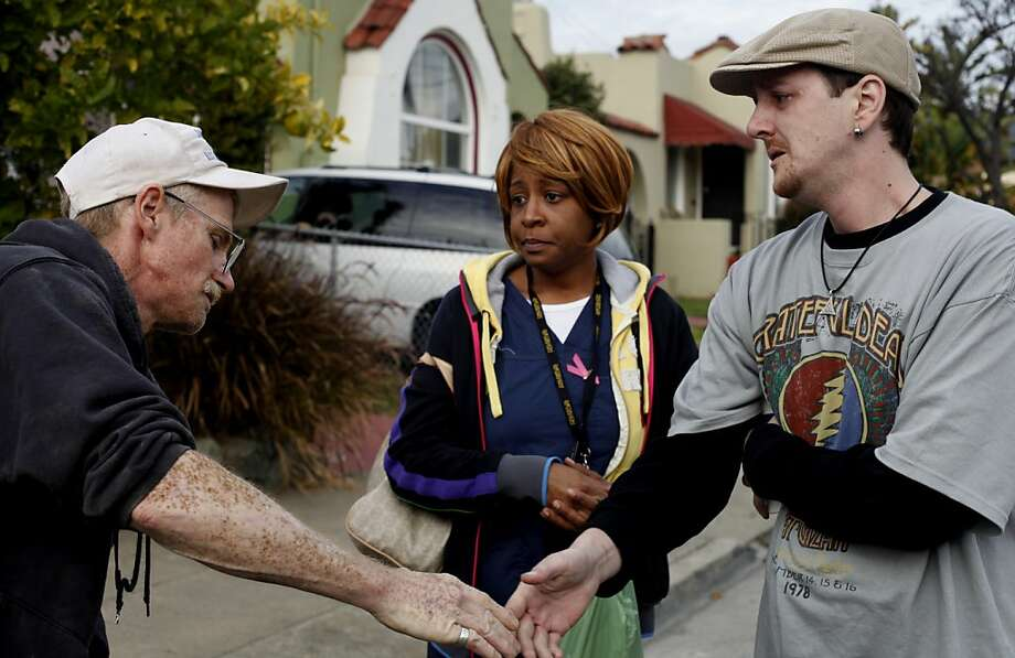 Chuck Briggs (left) thanks Monique Jefferson and Jeb Hamilton for caring for the girls in their final minutes. Photo: Lacy Atkins, The Chronicle