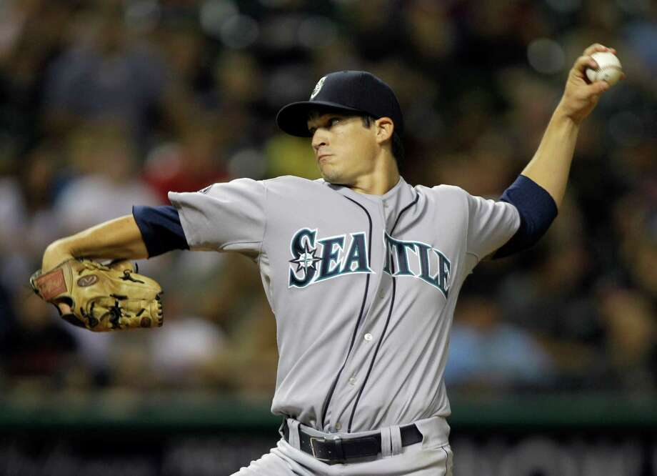 The Seattle Mariners' Anthony Vasquez pitches against the Cleveland Indians in the sixth inning of the second game of a baseball doubleheader Aug. 23, 2011, in Cleveland. Pitching in his major league debut, Vasquez got the win in the Mariners' 12-7 victory. Photo: Mark Duncan, Associated Press / AP