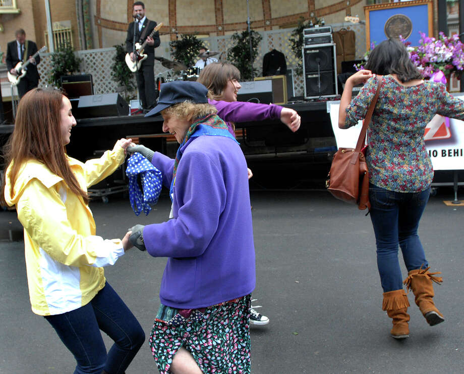 Danielle Shulkin, 16, of Troy, left, dances with Barbara Katz of Schenectady, center, to the music of the Charlie Watts Riots during the Tulip Festival on Saturday, May 8, 2010, at Washington Park in Albany, N.Y. (Cindy Schultz / Times Union archive) Photo: CINDY SCHULTZ