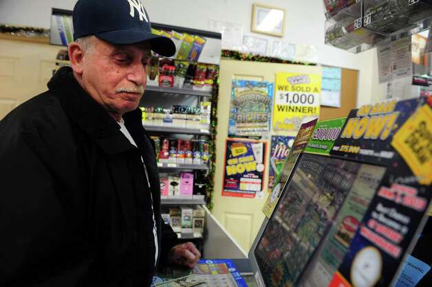 John Sibilio, of Shelton, purchases his daily lottery tickets Tuesday, Nov. 27, 2012 at the BP gas station in Shelton, Conn. Wednesday's Powerball has a jackpot of $500 million. Photo: Autumn Driscoll / Connecticut Post