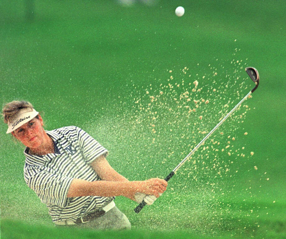 Wendy Ward blasts from a trap to the 18th green during the second round of the Fieldcrest-Cannon Classic at the Peninsula Club in Cornelius, N.C., Sept. 26, 1997. Ward is the second round leader at 13-under par. Photo: Bob Leverone, Associated Press / AP