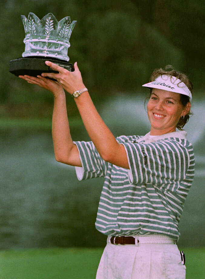 Wendy Ward holds up the LPGA Fieldcrest Cannon Classic trophy  Sept. 28, 1997, in Cornelius, N.C., after she broke an LPGA record by finishing the tournament at 23 strokes under par, three strokes better than the previous record. Photo: Rick Havner, Associated Press / AP