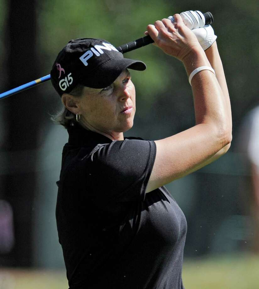Wendy Ward tees off on the 14th hole during the conclusion of the first round, that was delayed by weather, of the Women's U.S. Open golf tournament at the Broadmoor Golf Club on July 8, 2011, in Colorado Springs, Colo. Photo: Chris Carlson, Associated Press / AP