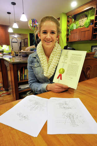 Zoe Eggleston, a Newtown High School senior, is the inventor and patent holder of the Ice Device, a machine that monitors ice thickness on bodies of water, telling the user if it is safe to walk on. Photo: Jason Rearick / The News-Times