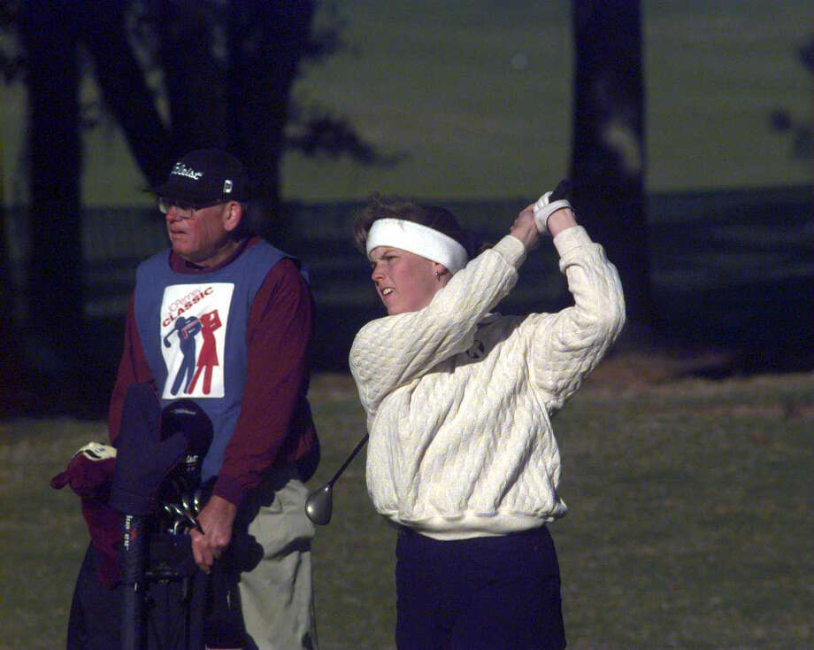 Wendy Ward, with father John Ward caddying, wears a headband to keep her ears warm in the chilly morning as she played the 5th hole in the final round of the JC Penney Classic. Photo: Tom Reel, San Antonio Express-News / SAN ANTONIO EXPRESS-NEWS