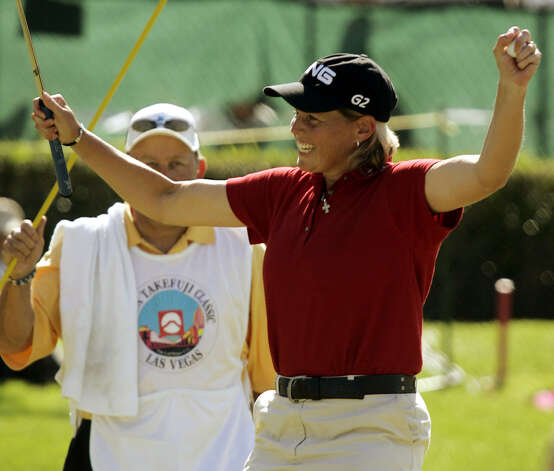 Wendy Ward celebrates after winning the LPGA's Takefuji Classic in Las Vegas on April 16, 2005. Ward finished at 16 under par, defeating Lorena Ochoa by two strokes. Photo: Joe Cavaretta, Associated Press / AP
