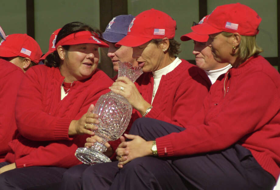United States team players (from left) Pat Hurst, Julie Inkster and Wendy Ward admire the Solheim cup after their victory over the European Solheim Cup at the Interlachen Country Club in Edina, Minn., Sept. 22, 2002. Photo: Janet Hostetter, Associated Press / AP