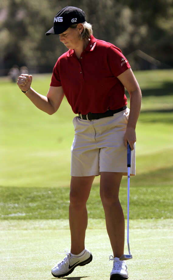 Wendy Ward reacts after sinking a birdie putt on the 12th hole in the Takefuji Classic at the Las Vegas Country Club, April 16, 2005. Ward finished at 16 under par with a score of 200. She lead the entire tournament. Photo: Joe Cavaretta, Associated Press / AP