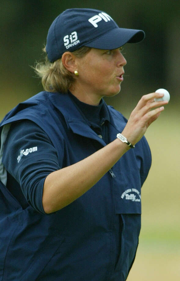 Wendy Ward of the United States collects the ball from the cup at the 18th green after her round on the first day of the Women's British Open golf Championship at Royal Lytham and St. Annes golf course in St. Annes, England, July 31, 2003. Ward was 5 under par at the end of her round. Photo: Alastair Grant, Associated Press / AP