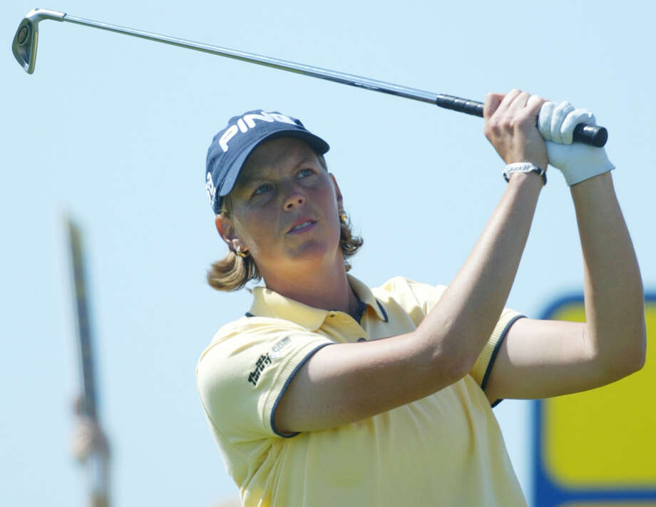 Wendy Ward of the United States plays a tee shot from the third hole during the final round of the Women's British Open Golf Championship at Royal Lytham and St. Annes golf course in St. Annes, England, Aug. 3. 2003. Photo: Alastair Grant, Associated Press / AP