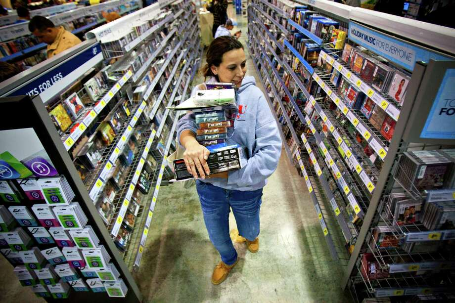 FILE -In this Friday, Nov. 23, 2012, file photo, Tonya Thomas, of Russellville, Ky., makes her way through the aisles at Best Buy in Bowling Green, Ky. U.S. consumer confidence rose this month to its highest level in almost five years, helped by a better outlook for hiring over the next six months. The Conference Board said Tuesday, Nov. 27, 2012, that its consumer confidence index rose to 73.7 in November from 73.1 in October. Both are the best readings since February 2008.  (AP Photo/Daily News, Alex Slitz) Photo: Alex Slitz