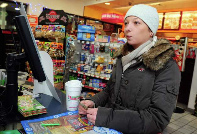 Kaitlin Tichy, 25, of Hamden, contemplates her Powerball purchase Tuesday, Nov. 27, 2012 at the BP gas station in Shelton, Conn. Tichy bought 16 tickets for Wednesday's Powerball with a jackpot of $500 million. Photo: Autumn Driscoll / Connecticut Post