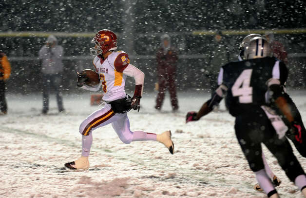 St. Joseph's #3 Jake Pelletier carries the ball 92 yards for a touchdown during Class M state football quarterfinal action against Hillhouse in East Haven, Conn. on Tuesday November 27, 2012. Photo: Christian Abraham / Connecticut Post