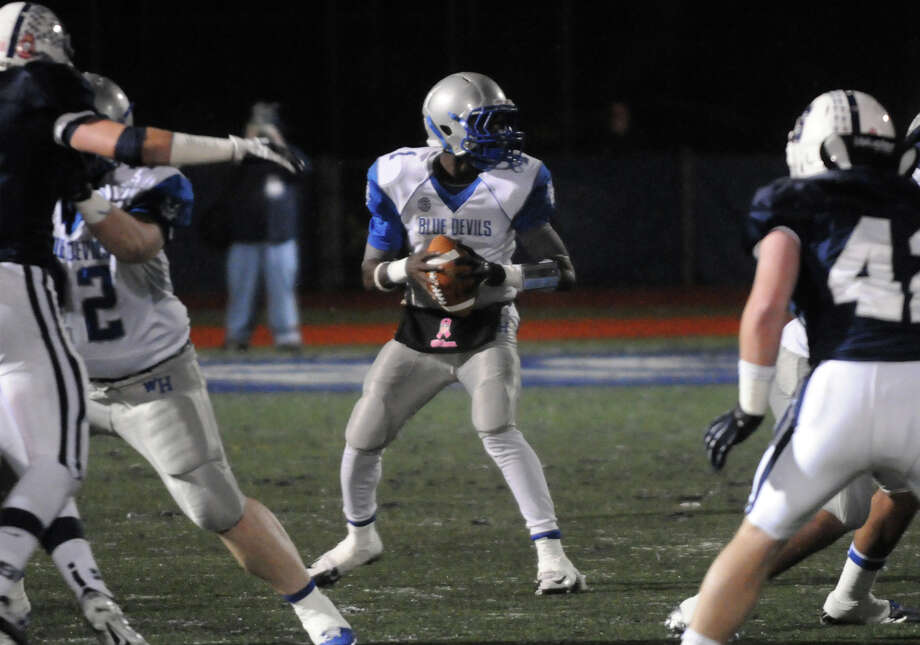 West Haven QB Ervin Philips moves the ball as Staples High School hosts West Haven in a Class LL football quarterfinals game in Westport, Conn., Nov. 27, 1012. Photo: Keelin Daly / Stamford Advocate Riverbend Stamford, CT