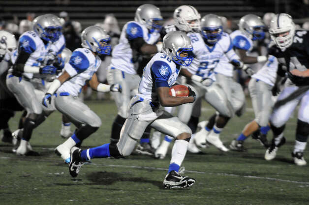 West Haven's Duane Gary carries as Staples High School hosts West Haven in a Class LL football quarterfinals game in Westport, Conn., Nov. 27, 1012. Photo: Keelin Daly / Stamford Advocate Riverbend Stamford, CT