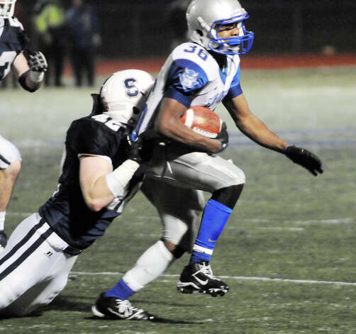 Staples' Kevin Kearney puts a stop to West Haven's Duane Gary Staples High School hosts West Haven in a Class LL football quarterfinals game in Westport, Conn., Nov. 27, 1012. Photo: Keelin Daly / Stamford Advocate Riverbend Stamford, CT