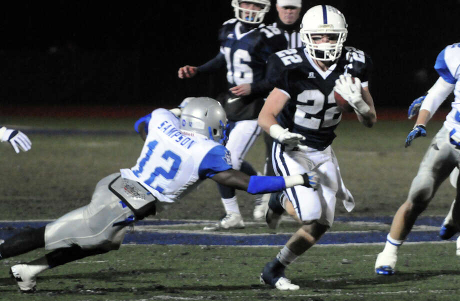 Staples' Joey Zelkowitz carries as Staples High School hosts West Haven in a Class LL football quarterfinals game in Westport, Conn., Nov. 27, 1012. Photo: Keelin Daly / Stamford Advocate Riverbend Stamford, CT