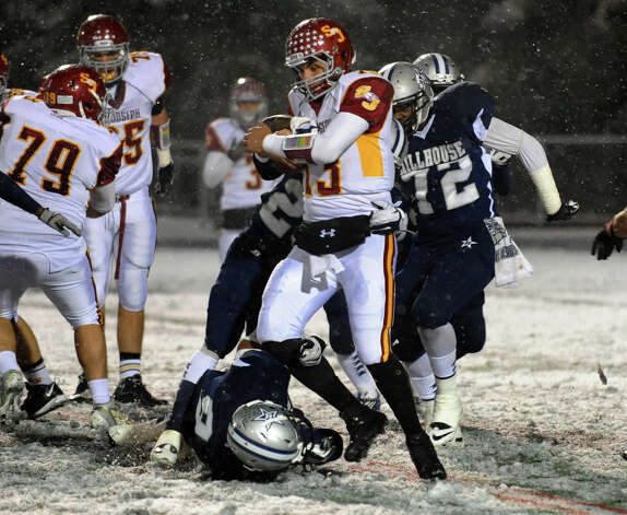 St. Joseph QB Jordan Vazzano is taken down by two Hillhouse players, during Class M state football quarterfinal action in East Haven, Conn. on Tuesday November 27, 2012. Photo: Christian Abraham / Connecticut Post