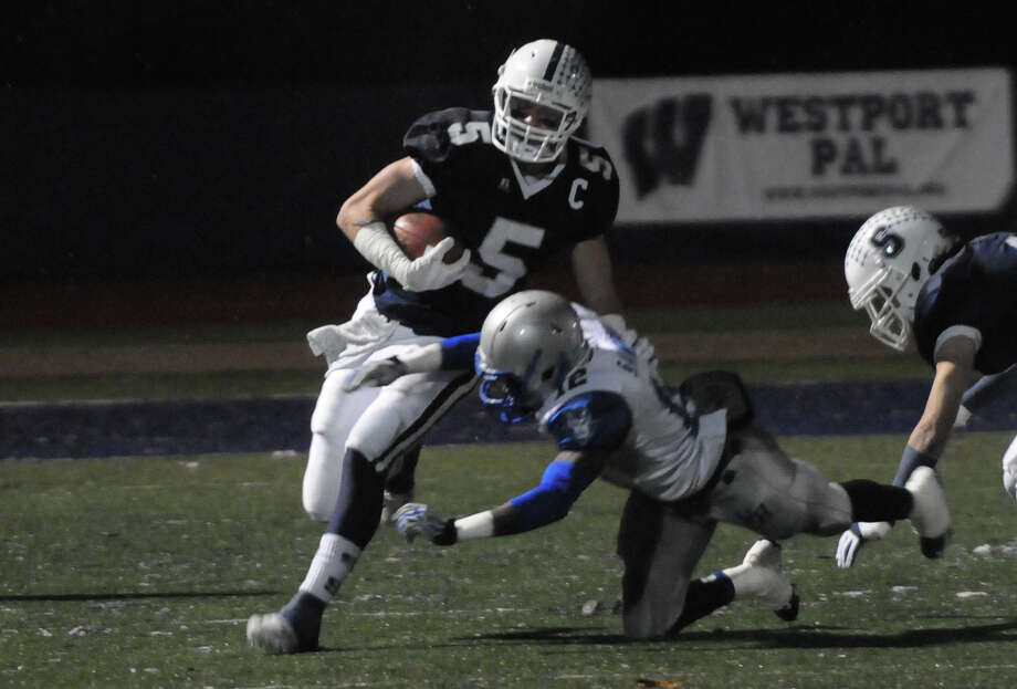 Staples' Nicholas Kelly carries as Staples High School hosts West Haven in a Class LL football quarterfinals game in Westport, Conn., Nov. 27, 1012. Photo: Keelin Daly / Stamford Advocate Riverbend Stamford, CT