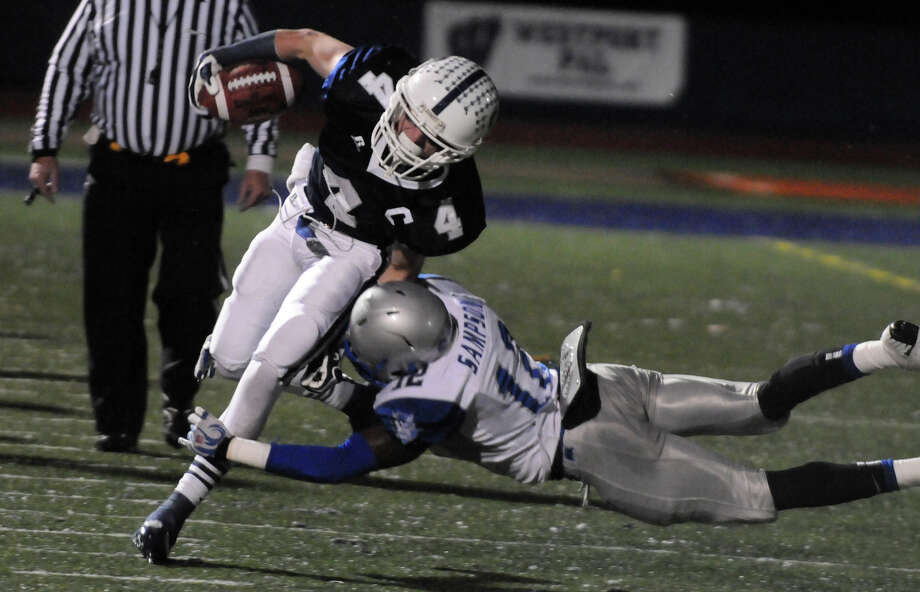 Staples' James Frusciante pushes for yards as Staples' Bobby Sampson tackles as Staples High School hosts West Haven in a Class LL football quarterfinals game in Westport, Conn., Nov. 27, 1012. Photo: Keelin Daly / Stamford Advocate Riverbend Stamford, CT