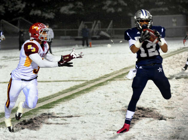 Hillhouse's #12 Daryn Horner intercepts a pass intended for St. Joseph's #3 Jake Pelletier, left, during Class M state football quarterfinal action in East Haven, Conn. on Tuesday November 27, 2012. Photo: Christian Abraham / Connecticut Post