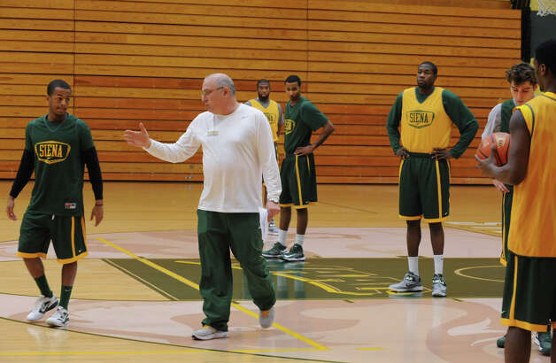 Siena basketball head coach Mitch Buonaguro talks to Evan Hymes during a drill at practice on Tuesday Nov. 27, 2012 in Loudonville, N.Y. The team is getting ready to play Massachusetts at the Times Union Center. (Lori Van Buren / Times Union) Photo: Lori Van Buren