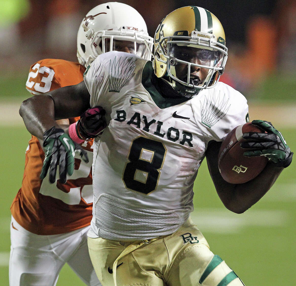Bears running back Glasco Martin is slowed up by Carrington Byndom in the second half as Texas hosts Baylor at Darrell K Royal - Texas Memorial Stadium Stadium on Oct. 20, 2012.