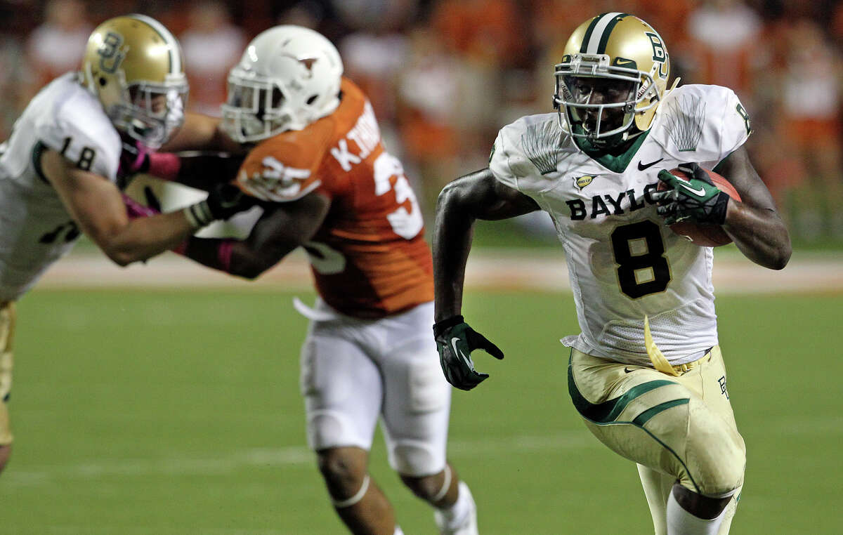 Bears running back Glasco Martin clears away in the second half as Texas hosts Baylor at Darrell K Royal - Texas Memorial Stadium Stadium on Oct. 20, 2012.